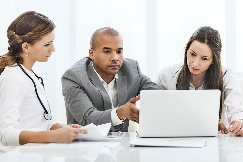 Healthcare workers in office, discussing