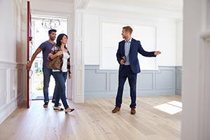 Realtor Showing Couple Around New Home