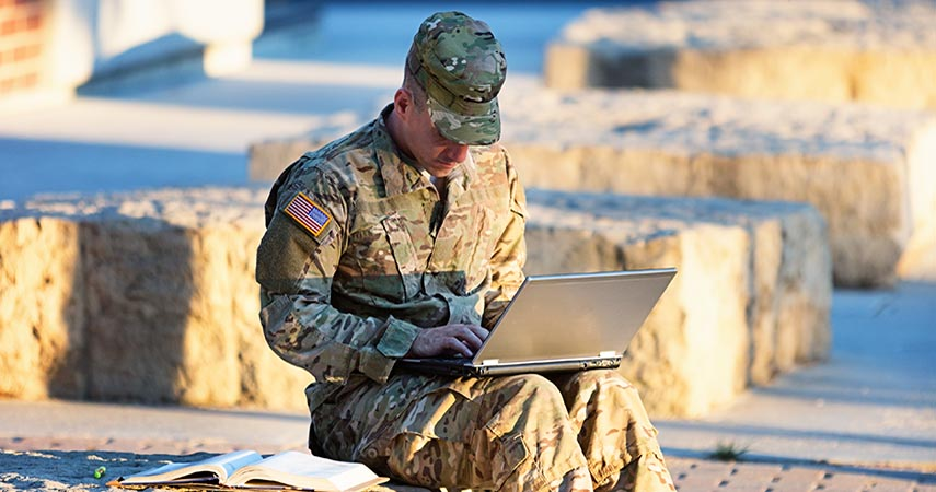 Military man on a laptop.