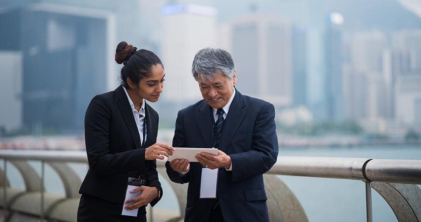 Businessman & woman going over papers